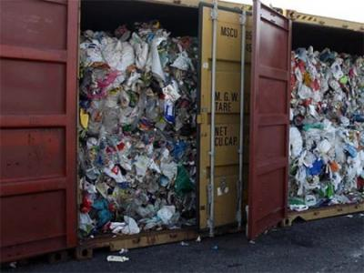 shipping container filled with garbage